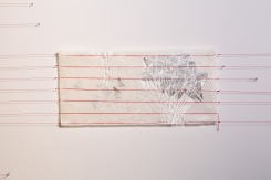 Latitude 4, paper that has red thread embedded in it photo transfers, marker, pen, graphite, wax, red thread, nails, 7.6 X 22 inches, 2016